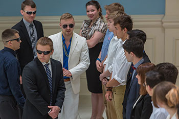 A security team of Liberty University students protect a potential mark in a simulated strategic intelligence exercise.