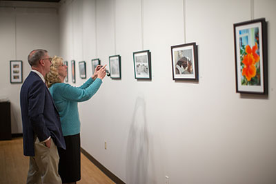 Guests enjoy an exhibition in the Liberty University Art Gallery.