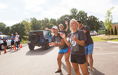Student leaders cheer as new students arrive on Liberty University's campus. (Photo by Kaitlyn Becker Johnson)