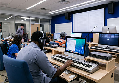 Liberty University School of Music students engage in classroom learning.