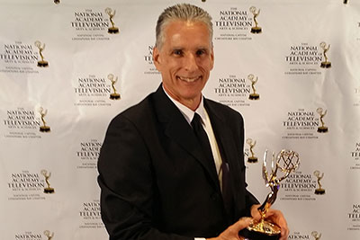 'Game On,' Liberty University's weekly sports television program, received an Emmy from the National Academy of Television Arts and Sciences for a feature on former Baltimore Ravens  and St. Louis Rams player Jason Brown.
