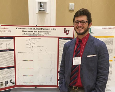 Recent Liberty University graduate Conner Fleming presents his research poster at the Virginia Academy of Science Annual Meeting.