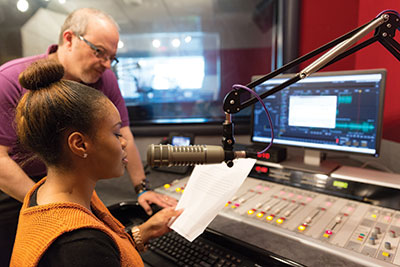 Imani Banks, a recent graduate, works at The Journey studio with Mike Weston, program director.