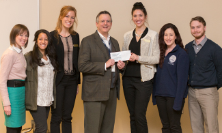 LUCOM-ACOOG officers accept grant from Dr. Eric Carlson.