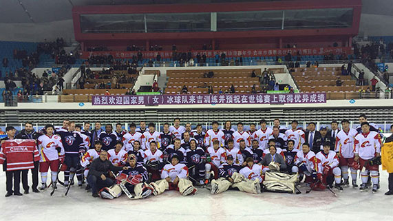 Liberty University's ACHA DI men's hockey team with a national team after a game in East Asia.