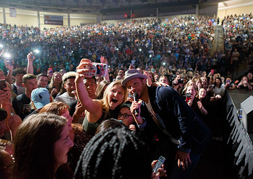 Backstreet Boy Brian Littrell interacts with Liberty University students as he performs the hit 'I Want It That Way' in Convocation on Wednesday. (Photos by Joel Coleman)