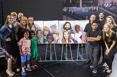 The Powell family (left) stands with a portrait of themselves created by members of Liberty University's Department of Studio & Digital Arts (right).