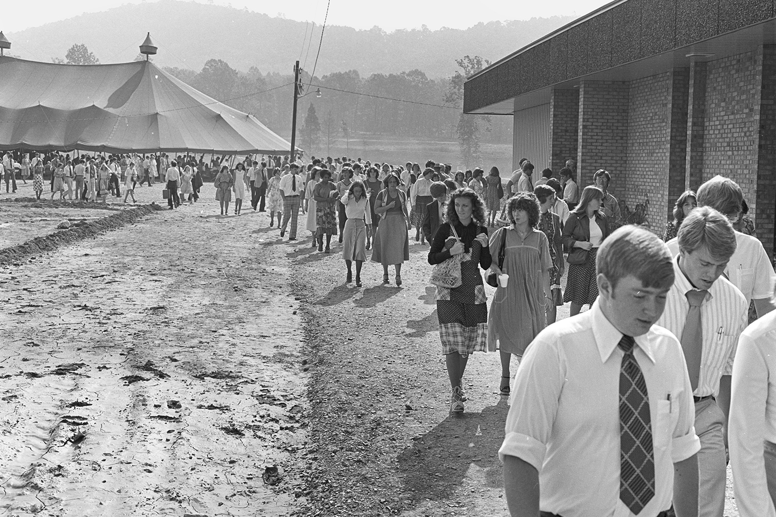 Students make their way out of the tent where chapel service was held in the 1970s.