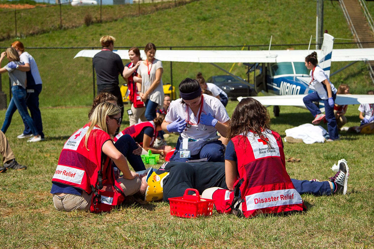 A simulated plane crash at Lynchburg Regional Airport gave aeronautics and nursing students the opportunity to test their mettle in the field. (Photos by Leah Seavers)