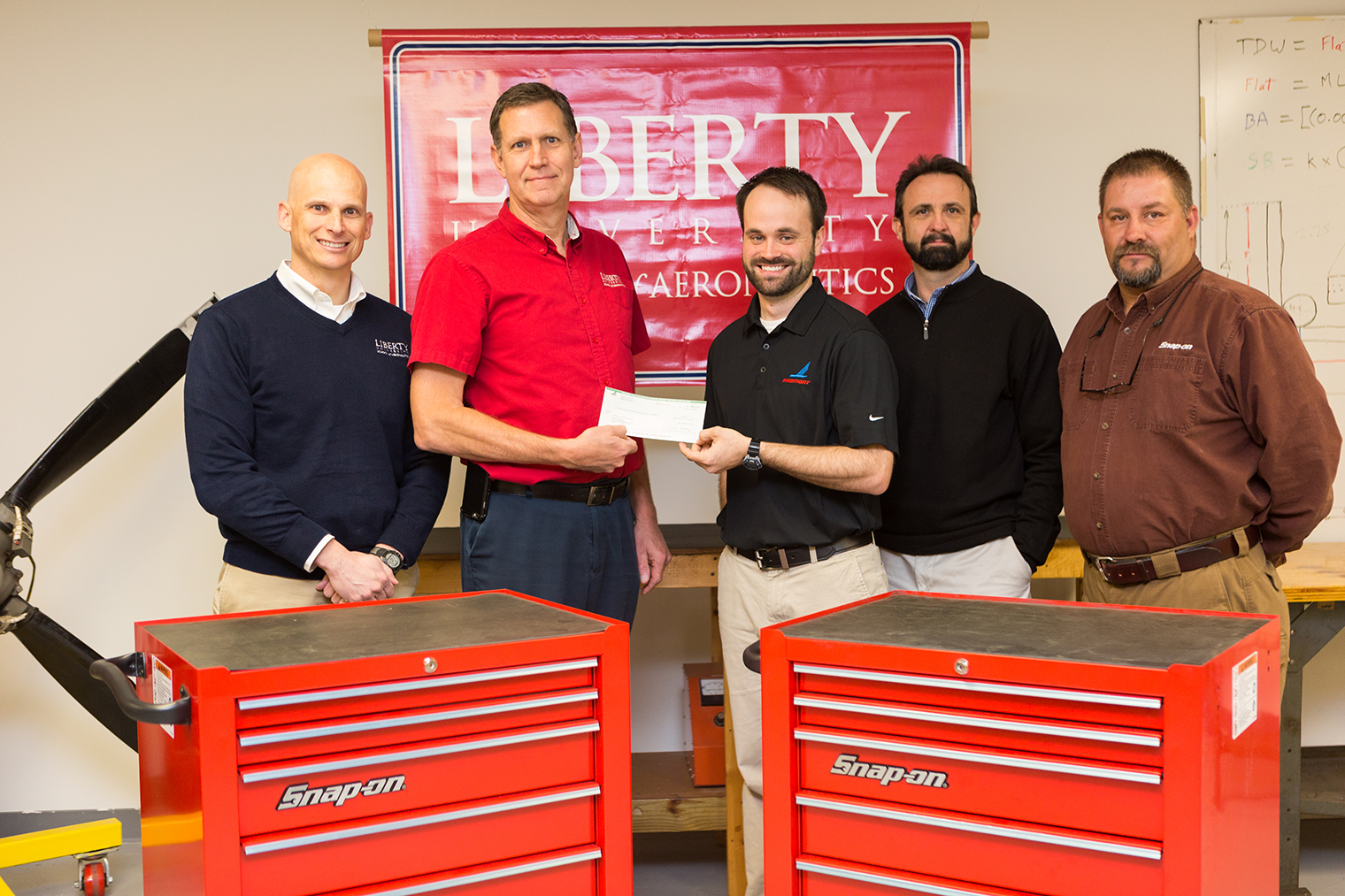 Bob Hudson (left), assistant dean of Liberty University School of Aeronautics, and Bob Howell, director of Liberty's Aviation Maintenance Technician Program, stand with representatives from Piedmont Airlines and Snap-on.