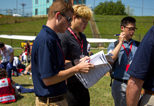 Aeronautics senior Cameron Row (left) works with the team of on-site managers to gather and disseminate information during the drill.