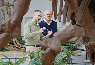 Ross explains to Tackett what dinosaurs can tell us about the Earth's origins.
