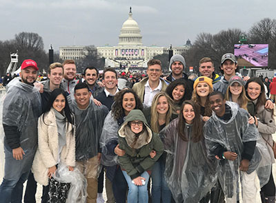 Students pose in front of the Captiol Building on Friday.