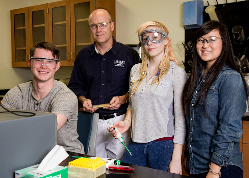 Dr. Greg Raner, Department of Biology & Chemistry professor, with his team of research students: senior Caleb Able (left), senior KaseyJo Wright, and junior Noelle Addair.