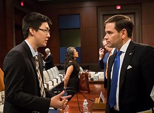Xia Chongyu with U.S. Sen. Marco Rubio following the hearing (Photo by Faith Wen/CECC)