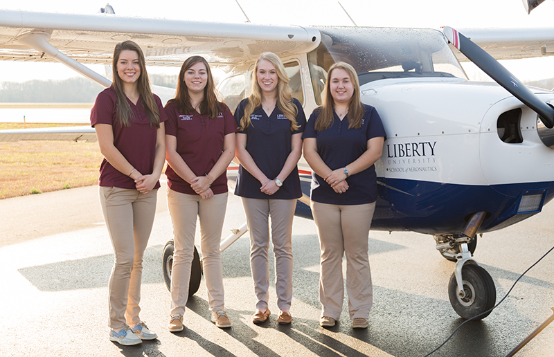 The Liberty Belles will compete in next week's Air Race Classic. Pilots are (from left): Audrey Rabe, Keegan Starkey, Allie Grubb, and Katie Wagner; not pictured: Jodi Yoder. (Photo by Kaitlyn Becker Johnson)