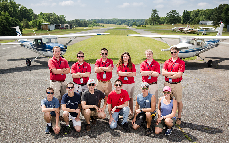 The first New Horizons private pilot training group: (Front row, from left) Timothy Cashman, Joel Cashman, Matt Bell, Joel Cihak, Dalton Joyce, and Kasey Boyer; (Back row, from left) Chris Cartwright, director; flight instructors Kit Conley, Zac Lamothe, Kaitlyn Allen, Josh Bulles, and John Adams.