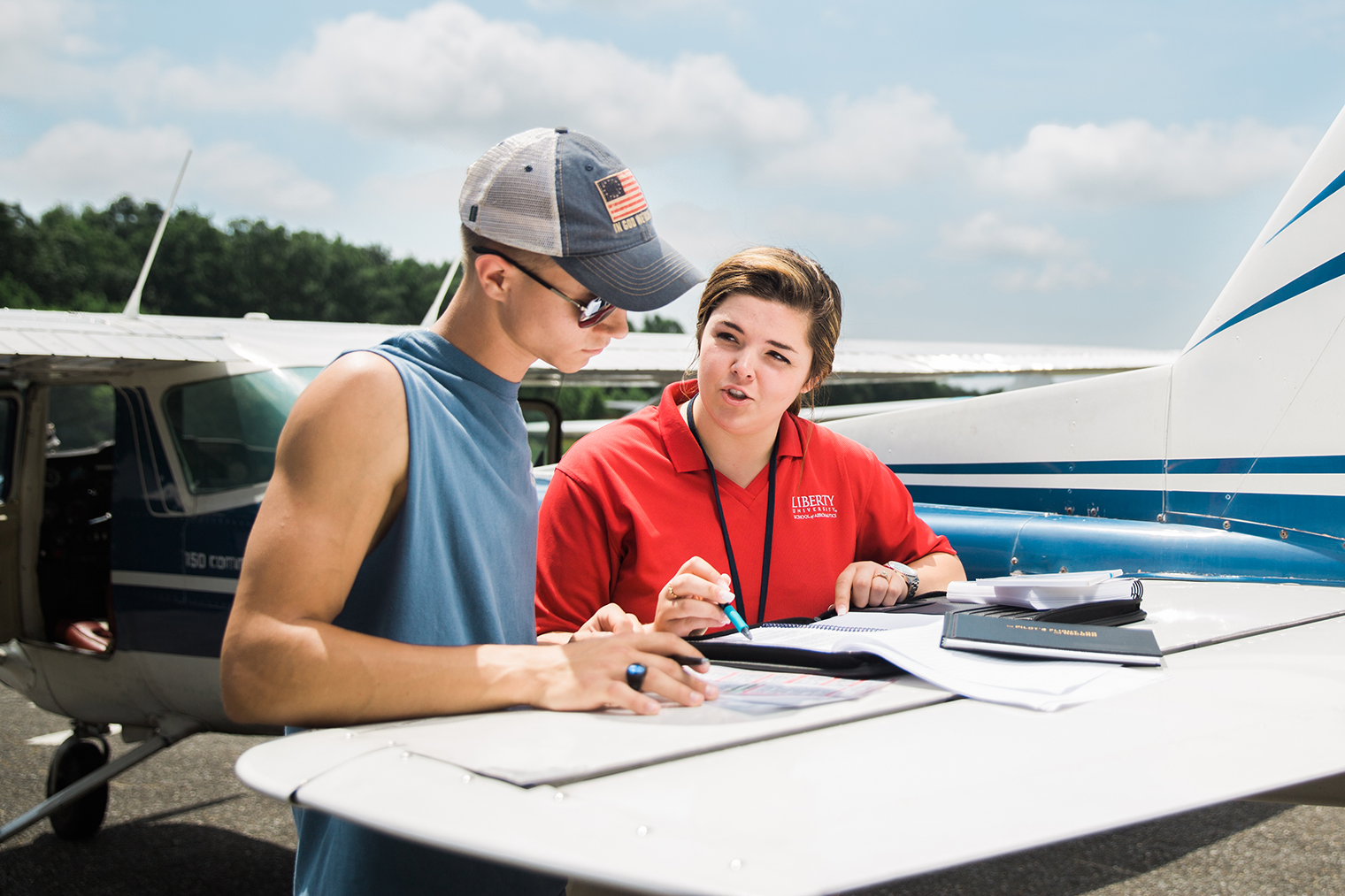 Dalton Joyce (left) discusses a flight plan with Kaitlyn Allen, his Liberty University flight instructor. (Photo by Kevin Manguiob)