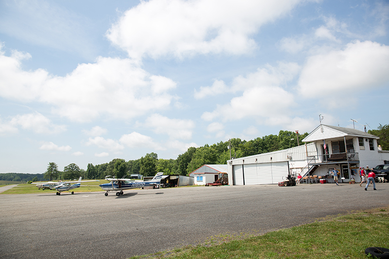 (Click image to enlarge) Participants in the New Horizons program do their flight training at New London Airport. (Photo by Kevin Manguiob)