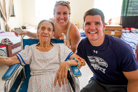 LUCOM student-doctor Joshua Reynolds, 2018, pictured with an elderly woman at Hope of Life International in Guatemala.