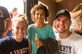 LUCOM student-doctor Joshua Reynolds, 2018, pictured with a child from Zacapa, Guatemala.