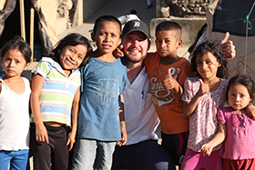 LUCOM student-doctor Joshua Reynolds, 2018, pictured with children from Zacapa, Guatemala.