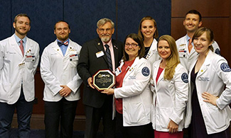 LUCOM founding dean, Ronnie B. Martin, DO, pictured with student-doctors