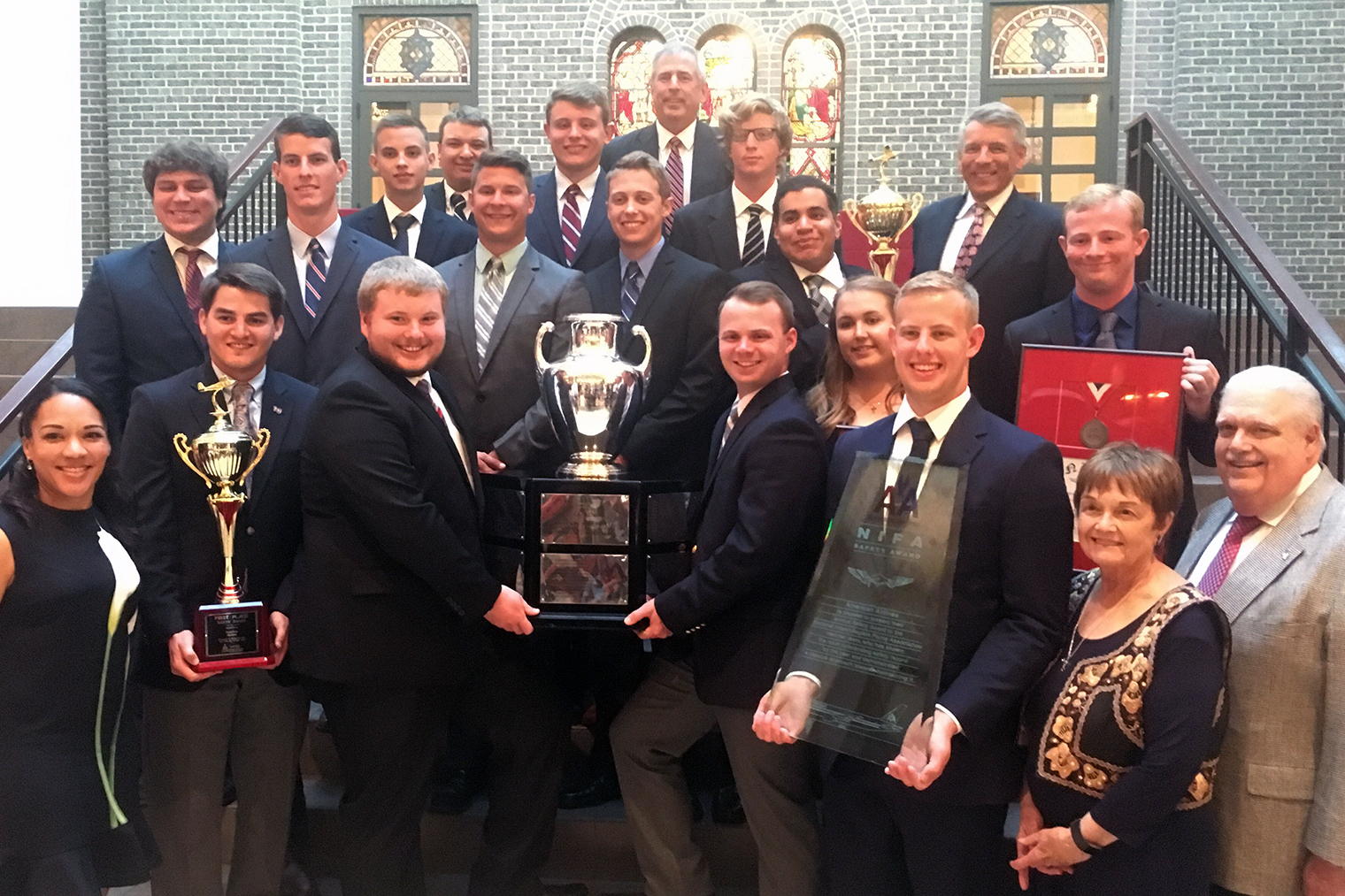 Liberty University's School of Aeronautics NIFA Flight Team poses with hardware it earned at nationals this year.