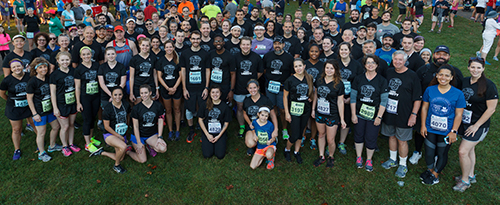 Liberty University faculty and staff gather together before the Virginia 10 and 4 Miler races. (Photo by Joel Coleman)