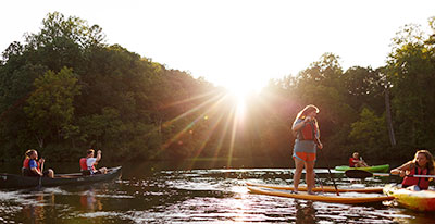 Students enjoy kayaking, canoeing, and stand-up paddleboarding at Hydaway Outdoor Recreation Center. (Photo by Joel Coleman)