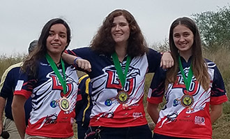 From left, Liberty freshman Hannah Suber and seniors Susannah Martin and Gwyneth Meyer placed third in women's basic bow.