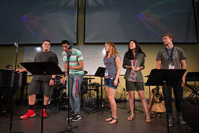 Choir members sing during a breakout session in the Music and Worship Camp.