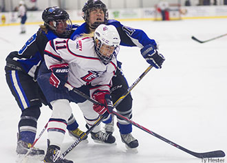 ACHA Division I women's hockey senior forward <a  data-cke-saved-href='index.cfm?PID=25956&TeamID=3&RosterID=1216' href='index.cfm?PID=25956&TeamID=3&RosterID=1216'>Sarah Stevenson</a> battles.