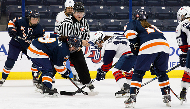 Senior forward Aly Morris, shown taking a faceoff vs. Midland, ranks 10th in the ACHA in points. (Photo by Jenna McKenney)  test test test test