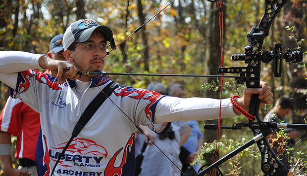 Alex Blake takes aim for the Flames at the U.S. Collegiate Archery Association 3-D National Championships. Blake and two teammates won the title in the Men's Team Compound event. test test test test