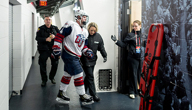 Liberty Club Sports Assistant Athletic Director of Sports Medicine Angie Witt ushers ACHA DI men's hockey senior defenseman Matt Cruickshank into the training room during a Dec. 7, 2018, game at the LaHaye Ice Center. (Photo by Joel Isimeme) test test test test
