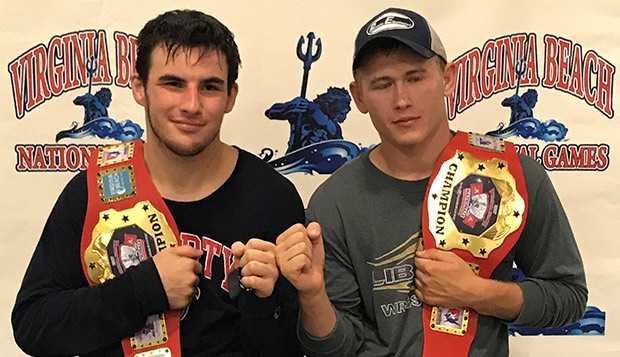 Liberty senior 235-pound wrestler Austin Amos (left) and 197-pound sophomore Cody Richmond pose with their championship belts at the Virginia Beach National Games. test test test test