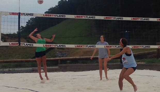 Lady Flames players Brittany Tyree (left), Lydia Smith, and Karyl Wiese (near court) play on new sand added to the beach courts beyond the East Campus Intramural Fields in late June. test test test test
