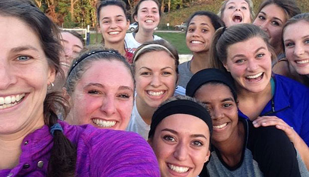 Members of Liberty's women's team pose for a selfie with Head Coach Rachel Willis (left) on East Campus beach courts test test test test