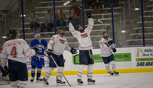 Junior forward Ben Freymond celebrates one of his two goals on the night with Liberty linemates Devon Docksteader (left) and Paul Ingles. test test test test