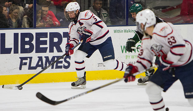 Liberty defenseman and head captain Ben Hughes (left) added an offensive spark last season, working alongside forward Bram Erickson (63), one of three alternate captains this year. test test test test