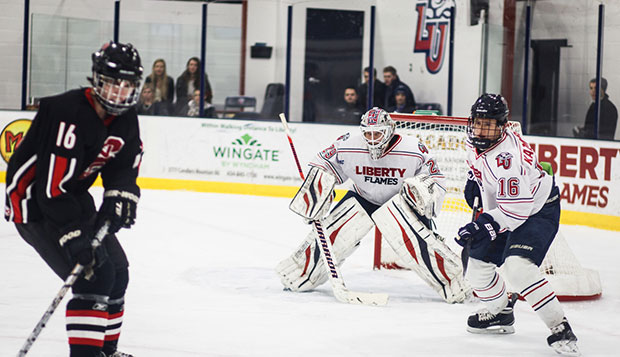 Liberty goalie Blair Bennett, flanked by junior forward Peter Kazmierczak, posted a shutout against North Carolina State, Friday at the LaHaye Ice Center. test test test test