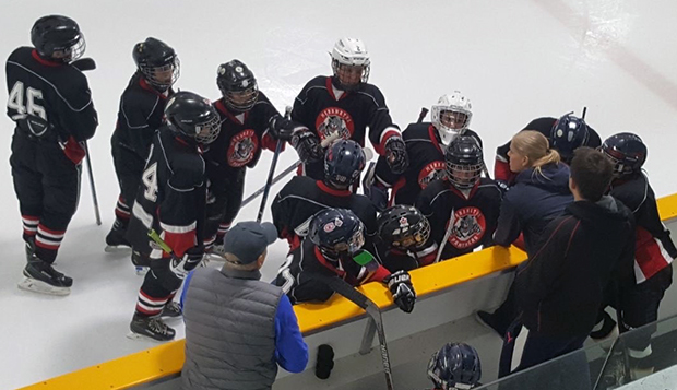 Carly Peleshok ('13, with pony tail) coached a boys hockey team in Windsor, Ontario, to its first-ever division championship. test test test test