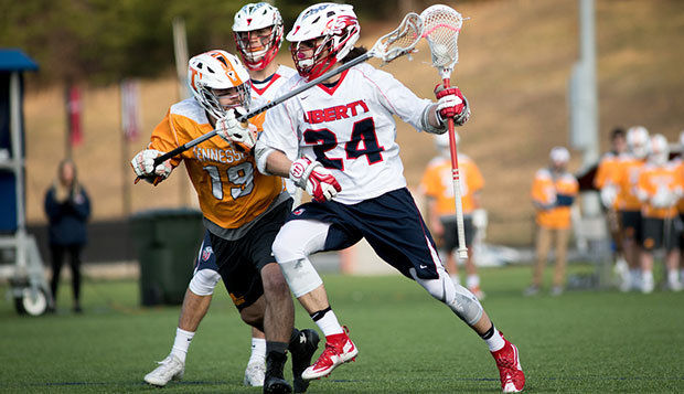 Flames freshman midfielder Carter Elliott charges past Volunteer defenders in Saturday afternoon's 18-4 triumph at the Liberty Lacrosse Fields. (Photo by Kevin Manguiob) test test test test