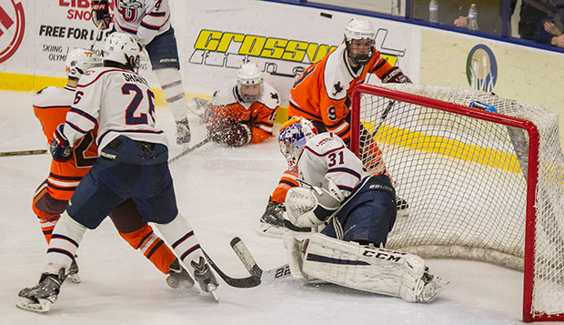 Cary Byron, shown making a save against Virginia Tech, went 15-9-3 in two seasons with Liberty's DI squad, with a goals-against average under 4.00 and a save percentage near 90.0. test test test test
