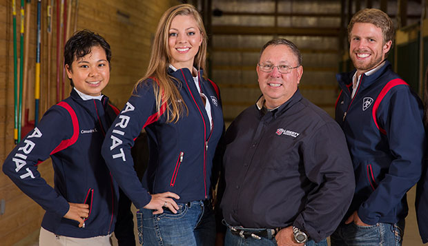 Liberty junior Cassandra Steptoe (left) and senior Micah Armbrust (right) pose with Head Coach Jim Arrigon and junior Western rider Kayla Sims (second from left). test test test test