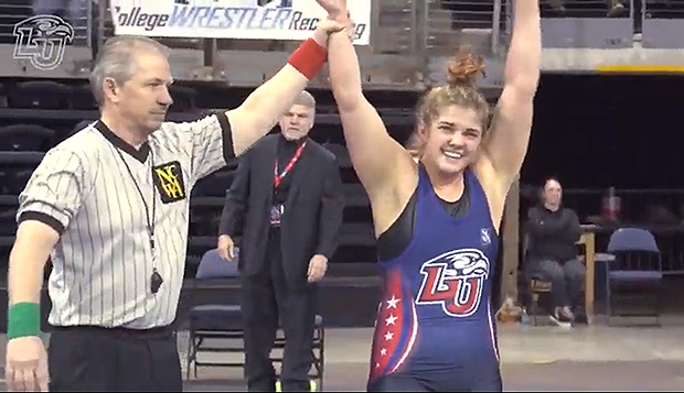 Cendall Manley raises her arms in victory after her third 170-pound NCWA Women's Grand National Championship crown. test test test test