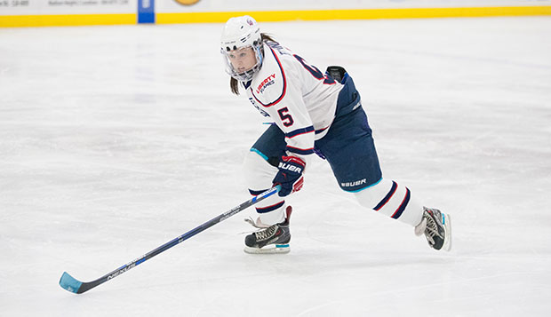 Liberty sophomore forward CJ Tipping assisted one of the Lady Flames' five goals on Saturday at the LaHaye Ice Center. test test test test