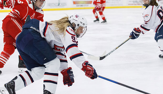 Senior forward Courtney Gilmour skates past a Miami (Ohio) player in the No. 3 Lady Flames' sweep of the No. 1 RedHawks. test test test test