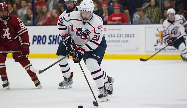 Liberty defensemen Kyle Crane (20) and Ben Hughes push the puck past Alabama in their Oct. 1 game at LaHaye Ice Center. test test test test